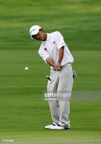 Pan Cheng Tsung of Chinese Taipei plays a chip shot during the final round of the Men's Individual Golf at the 15th Asian Games Doha 2006 in Doha...