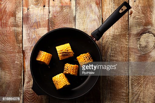 Pan Fried Corn on Rustic Wooden Table : Stock Photo