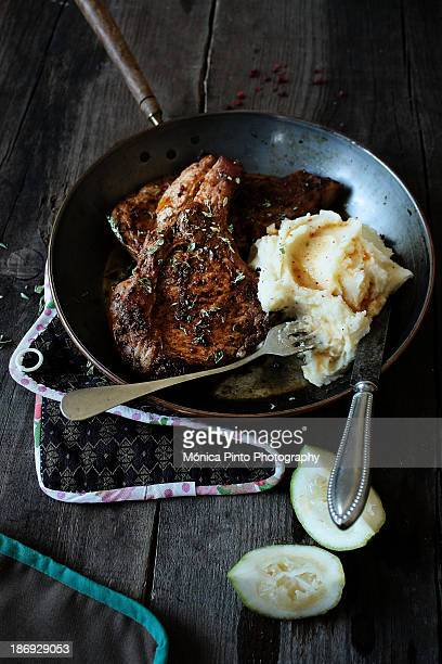 Pan fried pork chops and mashed potatoes