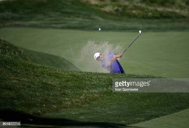 T Pan hits out of the sand on his approach to the 10th green during the second round of the Quicken Loans National on June 30 2017 at TPC Potomac at...