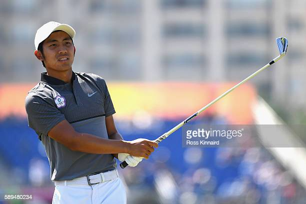 T Pan of Chinese Taipei plays his shot from the eighth tee during the final round of men's golf on Day 9 of the Rio 2016 Olympic Games at the Olympic...