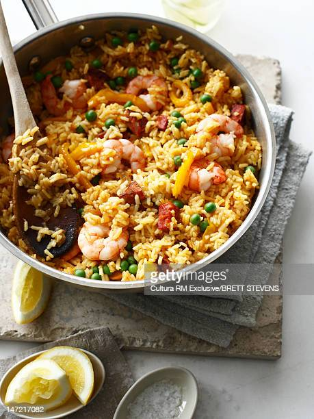 Pan of paella with lemon and salt