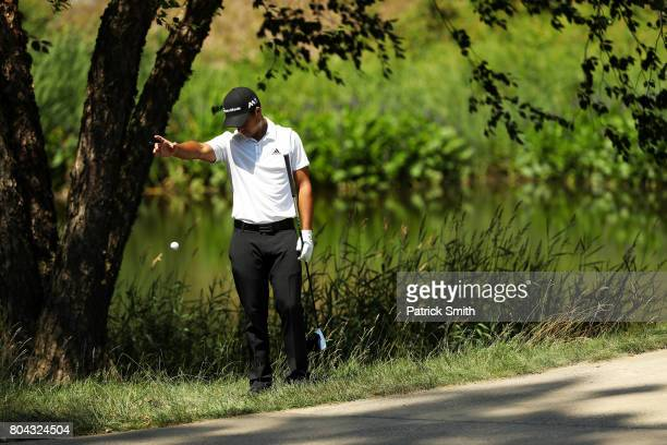 T Pan of Taipei takes a drop on the fifth hole during the second round of the Quicken Loans National on June 30 2017 TPC Potomac in Potomac Maryland