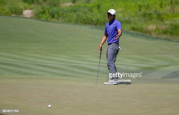 T Pan reacts to just missing his putt on the 10th green during the second round of the Quicken Loans National on June 30 2017 at TPC Potomac at...
