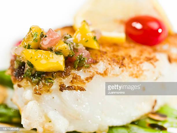 Pan Roasted fillet of fish with marinated tropical fruit sauce