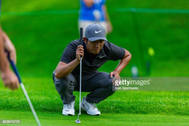 T Pan scans the green for his next putt during first round action of the RBC Canadian Open on July 27 at Glen Abbey Golf Club in Oakville ON Canada