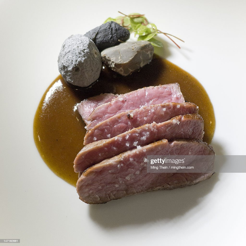 Pan seared lamb slices with rocks : Stock Photo