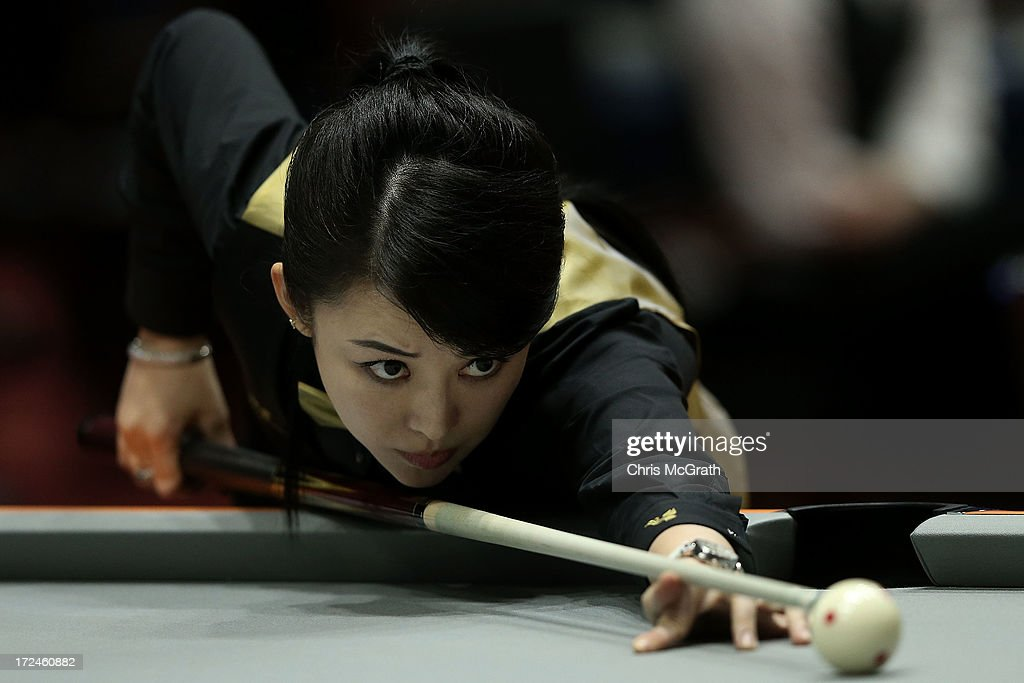 Pan Xiaoting of China plays a shot against Djajalie Klaudia of Malaysia during the Billiards, Women's 10 Ball Single Round of 32 Match at Songdo Convensia on day four of the 4th Asian Indoor & Martial Arts Games on July 2, 2013 in Incheon, South Korea.