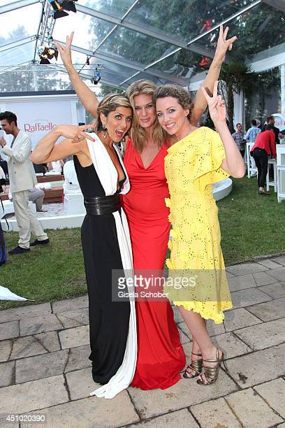 Panagiota Petridou Rachel Hunter and Sanny van Heteren attend the Raffaello Summer Day 2014 at Kronprinzenpalais on June 21 2014 in Berlin Germany