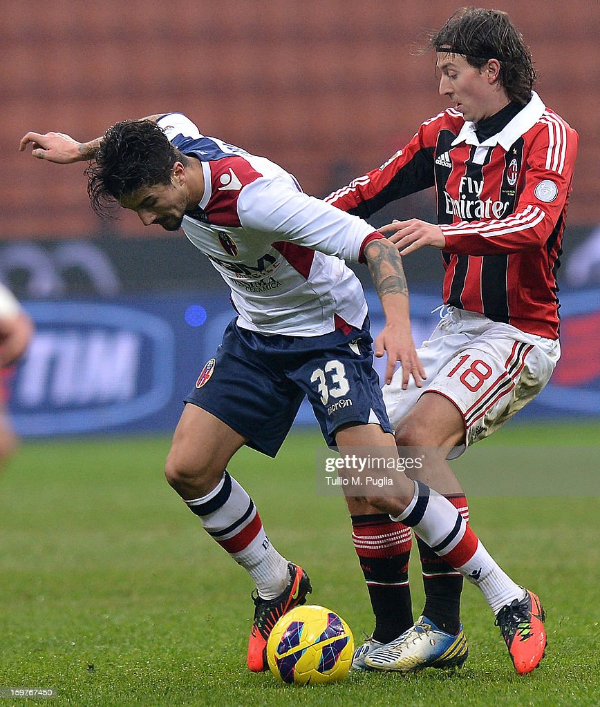 Panagiotis Kone (L) of Bologna and <a gi-track='captionPersonalityLinkClicked' href=/galleries/search?phrase=Riccardo+Montolivo&family=editorial&specificpeople=605846 ng-click='$event.stopPropagation()'>Riccardo Montolivo</a> of Milan compete for the ball during the Serie A match between AC Milan and Bologna FC at San Siro Stadium on January 20, 2013 in Milan, Italy.