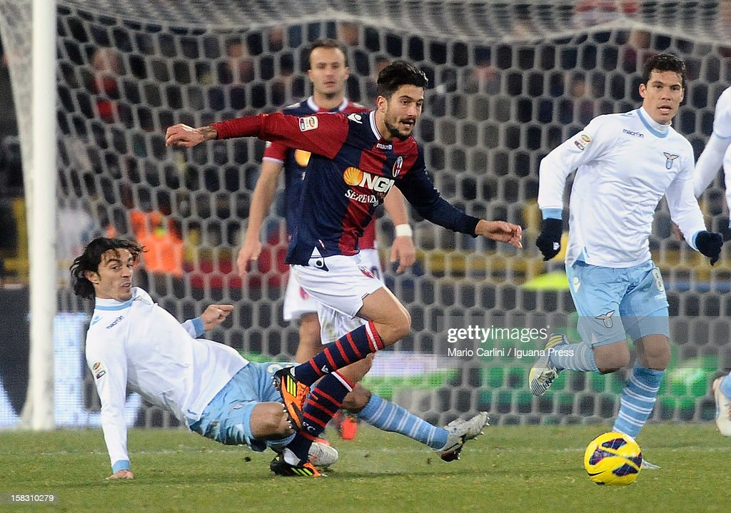 Panagiotis Kone # 33 of Bologna FC is challenged by Giuseppe Biava (L) of SS Lazio during the Serie A match between Bologna FC and S.S. Lazio at Stadio Renato Dall'Ara on December 10, 2012 in Bologna, Italy.