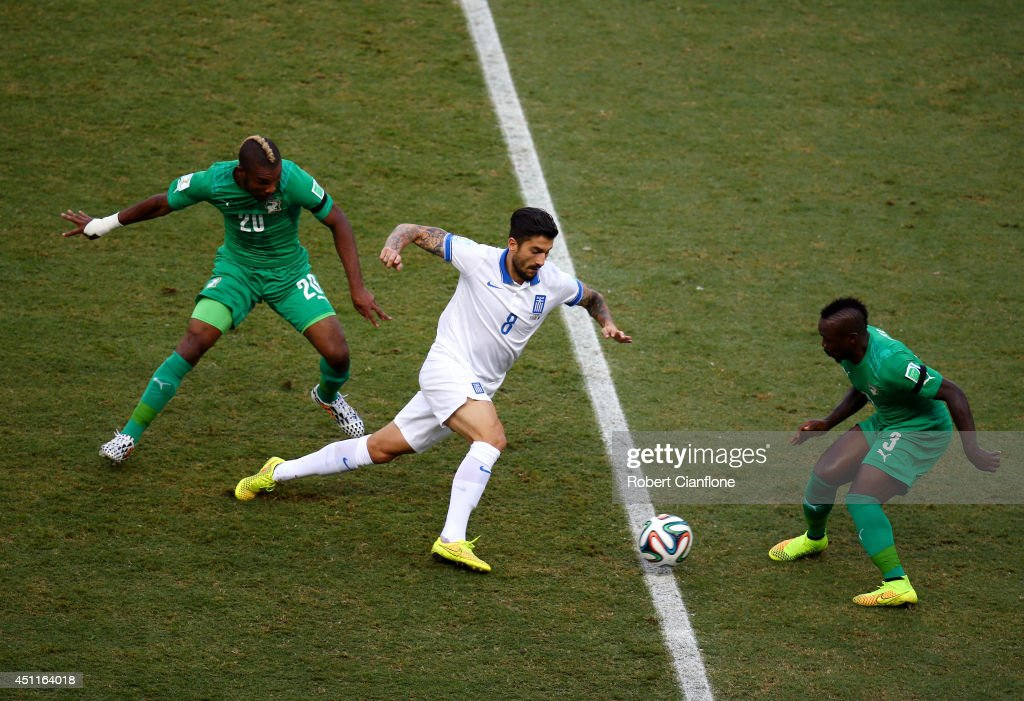 Panagiotis Kone of Greece is challenged by Die Serey (L) and <a gi-track='captionPersonalityLinkClicked' href=/galleries/search?phrase=Arthur+Boka&family=editorial&specificpeople=550855 ng-click='$event.stopPropagation()'>Arthur Boka</a> of the Ivory Coast during the 2014 FIFA World Cup Brazil Group C match between Greece and the Ivory Coast at Castelao on June 24, 2014 in Fortaleza, Brazil.