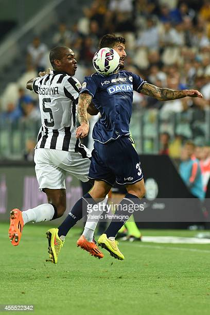 Panagiotis Kone of Udinese Calcio clashes with Angelo Ogbonna of Juventus FC during the Serie A match between Juventus FC and Udinese Calcio at...