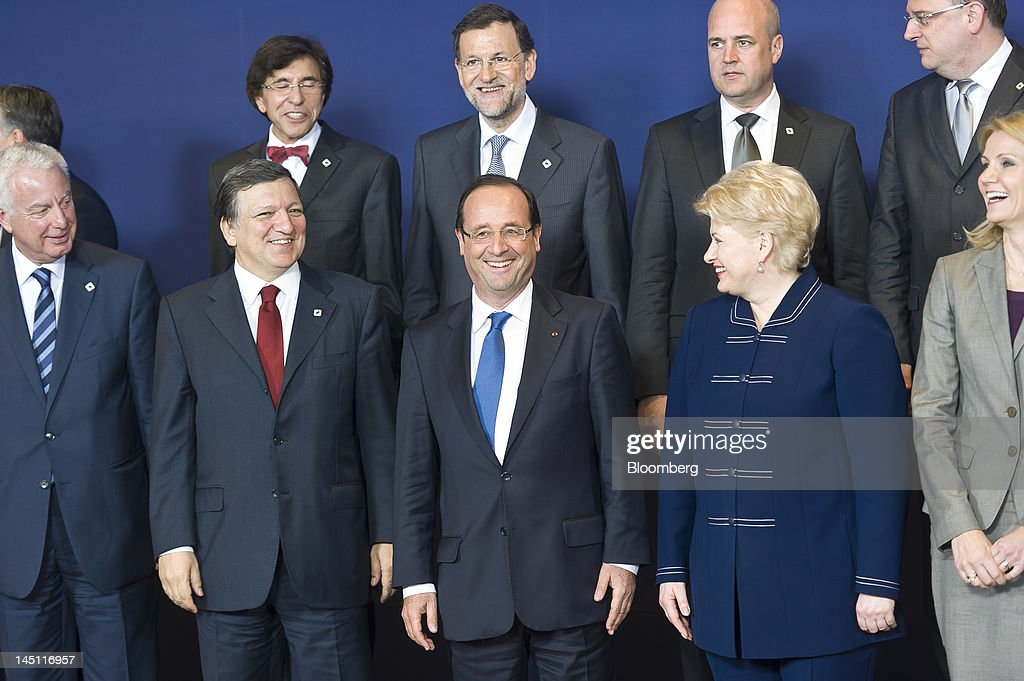 Panagiotis Pikrammenos, Greece's prime minister, from left front row, Jose Manuel Barroso, president of the European Commission, Francois Hollande, France's president, <a gi-track='captionPersonalityLinkClicked' href=/galleries/search?phrase=Dalia+Grybauskaite&family=editorial&specificpeople=654850 ng-click='$event.stopPropagation()'>Dalia Grybauskaite</a>, Lithuania's president, and <a gi-track='captionPersonalityLinkClicked' href=/galleries/search?phrase=Helle+Thorning-Schmidt&family=editorial&specificpeople=2485486 ng-click='$event.stopPropagation()'>Helle Thorning-Schmidt</a>, Denmark's prime minister, pose for a family photograph, with from left back row, <a gi-track='captionPersonalityLinkClicked' href=/galleries/search?phrase=Elio+Di+Rupo&family=editorial&specificpeople=743705 ng-click='$event.stopPropagation()'>Elio Di Rupo</a>, Belgium's prime minister, <a gi-track='captionPersonalityLinkClicked' href=/galleries/search?phrase=Mariano+Rajoy+Brey&family=editorial&specificpeople=551714 ng-click='$event.stopPropagation()'>Mariano Rajoy Brey</a>, Spain's prime minister, <a gi-track='captionPersonalityLinkClicked' href=/galleries/search?phrase=Fredrik+Reinfeldt&family=editorial&specificpeople=861728 ng-click='$event.stopPropagation()'>Fredrik Reinfeldt</a>, Sweden's prime minister, and <a gi-track='captionPersonalityLinkClicked' href=/galleries/search?phrase=Petr+Necas&family=editorial&specificpeople=3014277 ng-click='$event.stopPropagation()'>Petr Necas</a>, prime minister of the Czech Republic, during the European Leaders (EU) summit at the European Council headquarters in Brussels, Belgium, on Wednesday, May 23, 2012. The summit, the 18th since Greece was convulsed by debt and the first since an anti-austerity campaign carried Hollande to France's presidency, takes place with market indicators showing mounting stress on banks. Photographer: Jock Fistick/Bloomberg via Getty Images