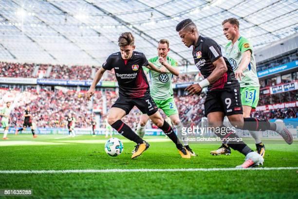 Panagiotis Retsos Maximilian Arnold of Wolfsburg Leon Bailey of Leverkusen and Yannick Gerhardt of Wolfsburg in action during the Bundesliga match...