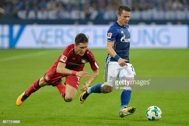 Panagiotis Retsos of Leverkusen and Yevhen Konoplyanka of Schalke battle for the ball during the Bundesliga match between FC Schalke 04 and Bayer 04...