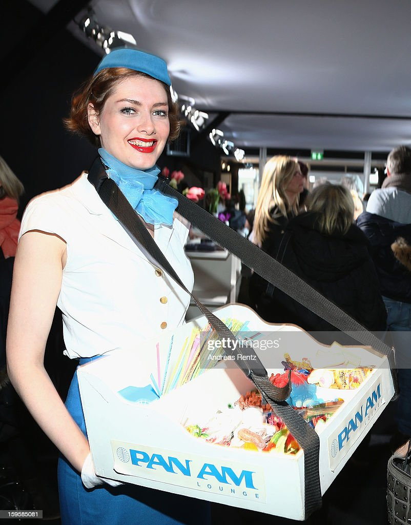 PanAm hostesses distribute sweets during Dimitri Autumn/Winter 2013/14 fashion show during Mercedes-Benz Fashion Week Berlin at Brandenburg Gate on January 16, 2013 in Berlin, Germany.