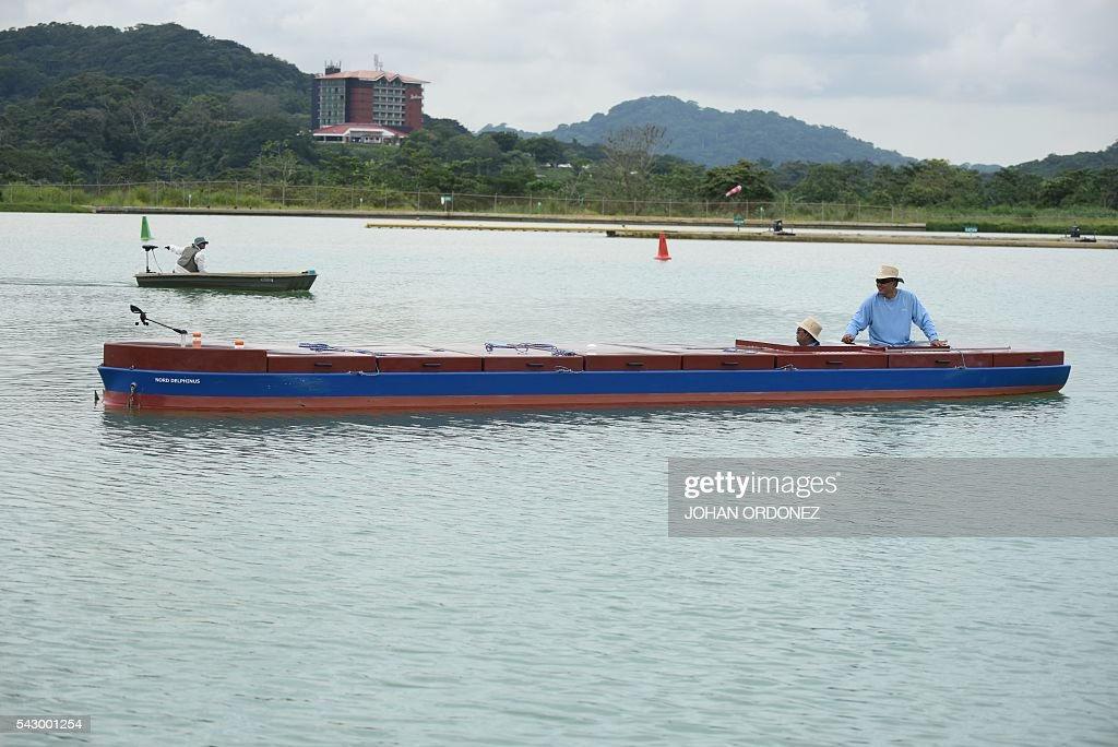 A Panama Canal tug boat pilot practices maneuvers with scale model vessels on a reservoir next to the Canal, west of Panama City on June 25, 2016. Panama will officially open its canal on Sunday to far bigger cargo ships after nearly a decade of expansion work aimed at boosting transit revenues and global trade. On Sunday, a VIP ceremony will be held on the banks of the canal to inaugurate the completion of the works. / AFP / JOHAN