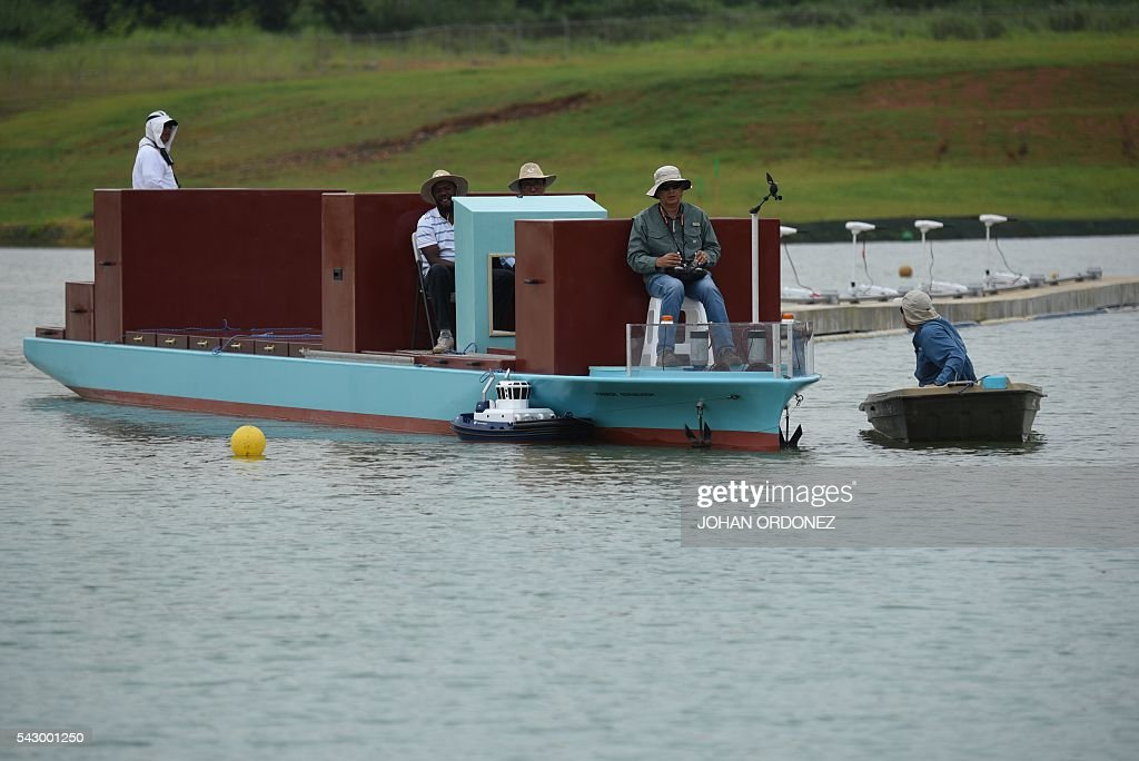 Panama Canal tug boat pilots practice maneuvers with scale model vessels on a reservoir next to the Canal, west of Panama City on June 25, 2016. Panama will officially open its canal on Sunday to far bigger cargo ships after nearly a decade of expansion work aimed at boosting transit revenues and global trade. On Sunday, a VIP ceremony will be held on the banks of the canal to inaugurate the completion of the works. / AFP / JOHAN