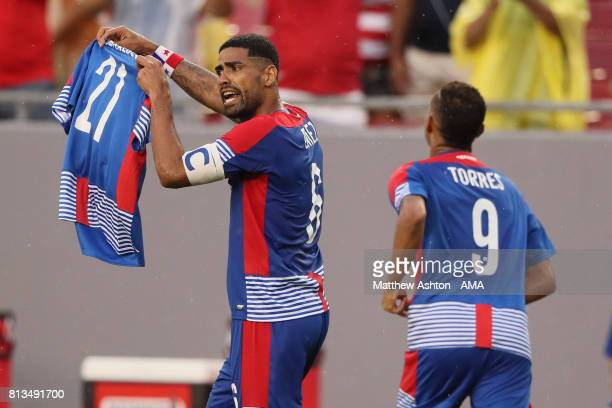 Panama captain Gabriel Gomez holds up the shirt of Amilcar Henriquez who was shot dead in April 2017 in his hometown of Nuevo Colon and played for...