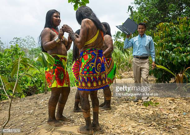 Panama Darien province Bajo Chiquito Embera indians in traditional clothing dancing on the sound of a computer on April 13 2015 in Bajo Chiquito...