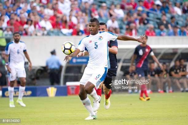 Panama Defender Fidel Escobar keeps the ball away from Costa Rica Midfielder David Guzmán in the first half during the CONCACAF Gold Cup Quarterfinal...