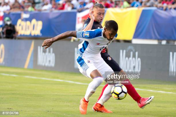 Panama Defender Michael Murillo keeps the ball from Costa Rica Forward David Ramírez in the first half during the CONCACAF Gold Cup Quarterfinal game...
