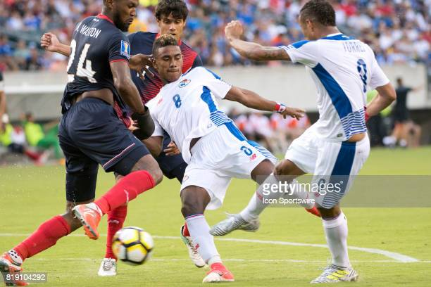 Panama Forward Gabriel Torres and Panama Midfielder Edgar Barcenas both go for a shot in front of the net in the second half during the CONCACAF Gold...