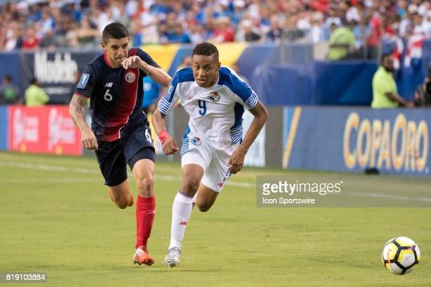 Panama Forward Gabriel Torres chases down the ball ahead of Costa Rica Defender José Salvatierra in the second half during the CONCACAF Gold Cup...