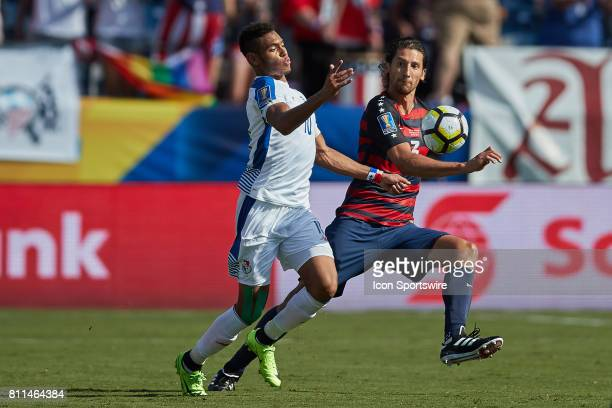 Panama forward Ismael Diaz battles with United States defender Omar Gonzlez for a loose ball during a CONCACAF Gold Cup Group B match between the...