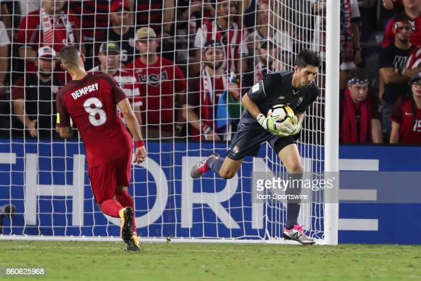 Panama goalkeeper Jaime Penedo blocks a shot on goal from USA forward Clint Dempsey during the World Cup Qualifying soccer match between the US Mens...