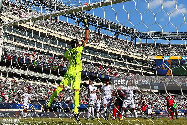 Panama goalkeeper Jaime Penedo goes up to knock the ball away during the first half of the CONCACAF Gold Cup quarterfinal game between the Trinidad...