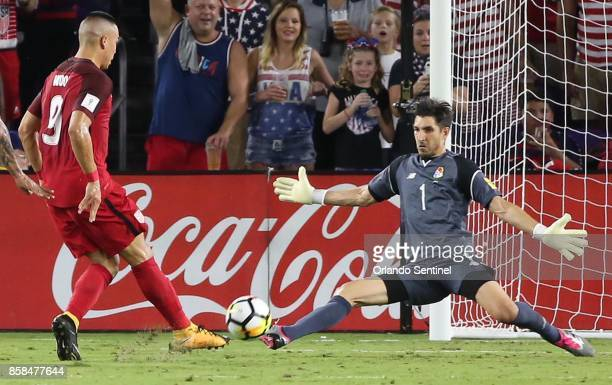 Panama goalkeeper Jaime Penedo stops a goal shot by USA player Bobby Wood during World Cup qualifier match at Orlando City Stadium on Friday Oct 6 in...