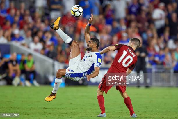Panama midfielder Gabriel Gomez attempts a bicycle kick to clear the ball against United States midfielder Christian Pulisic during the World Cup...