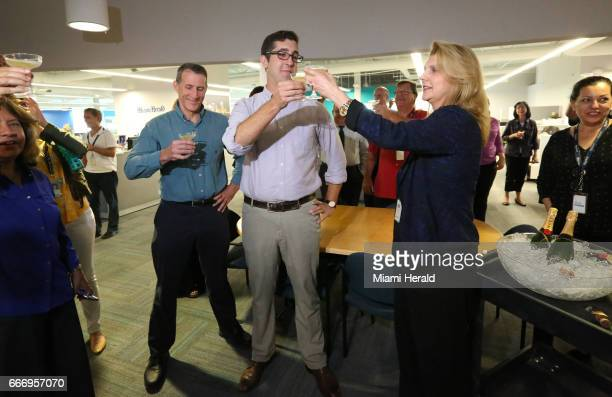 Panama Papers reporter Nicholas Nehamas shares a toast of champagne with Miami Herald President and Publisher Alex Villoch during the paper's...