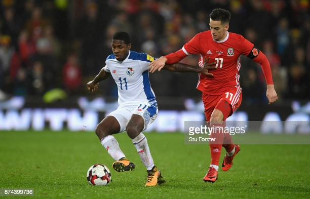 Panama player Armando Cooper holds off the challenge of Tom Lawrence of Wales during the International Friendly match between Wales and Panama at...