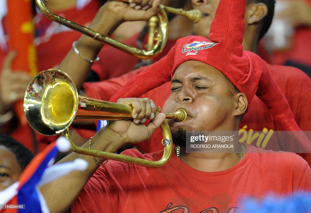Panamanian football supporters play trumpets before the match against Honduras for the Brazil 2014 FIFA World Cup North, Central America and Caribbean qualifiers in Panama City, on October 12, 2012. AFP PHOTO/Rodrigo ARANGUA