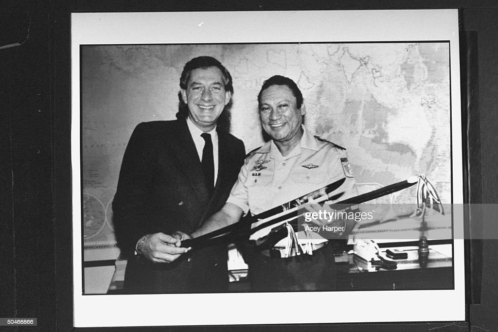 Panamanian Gen. Manuel Noriega giving his defense attorney Frank Rubino a machete.