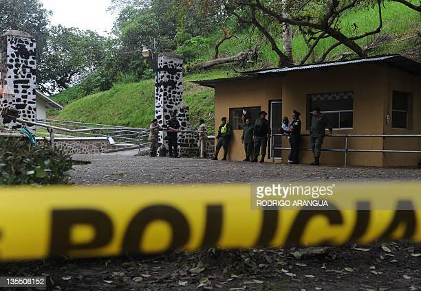 Panamanian policemen keep watch inside the Renacer prison 25 km south east of Panama City on December 11 before the arrival of Panama's former...