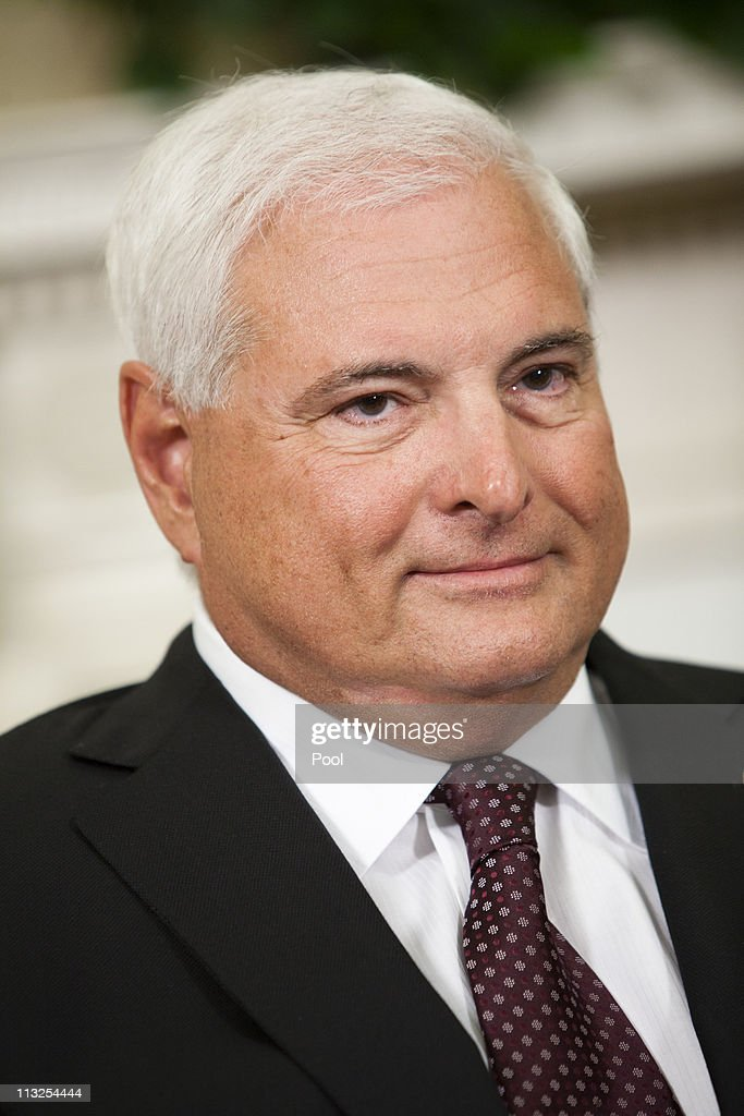Panamanian President <a gi-track='captionPersonalityLinkClicked' href=/galleries/search?phrase=Ricardo+Martinelli&family=editorial&specificpeople=3042222 ng-click='$event.stopPropagation()'>Ricardo Martinelli</a> listens as U.S. President Barack Obama talks to reporters after their meeting in the Oval Office at the White House on April 28, 2011 in Washington, DC. Obama and Martinelli discussed free-trade between the two countries as well as expressing concerns about drugs in both countries.