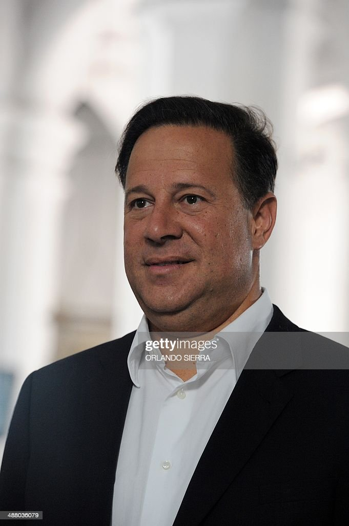 Panamanian presidential candidate for the Panamenista Party (PP), <a gi-track='captionPersonalityLinkClicked' href=/galleries/search?phrase=Juan+Carlos+Varela&family=editorial&specificpeople=5906542 ng-click='$event.stopPropagation()'>Juan Carlos Varela</a>, smiles in Panama City, on May 3, 2014, on the eve of presidential elections. AFP PHOTO/Orlando SIERRA.