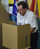 Panamanian presidential candidate Juan Carlos Navarro of the Partido Revolucionario Democratico prepares to cast his vote at a polling station in...