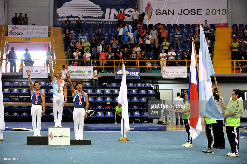 Panamanian silver medal Raul Perez (R), Guatemalan Mynor Juarez, gold medal (C) and Panamanian Vidiel Aguilar, bronze medal (L) in the podium of gymnastic rings in the 10th Central American Games in San Jose on March 8, 2013. The 10th Central American Games are taking place from March 3 to 17 in Costa Rica. AFP PHOTO / Ezequiel BECERRA