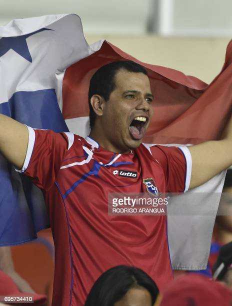 A Panamanian supporter cheers with a national flag as he waits for the beginning of the FIFA World Cup Russia 2018 Concacaf qualifier match against...
