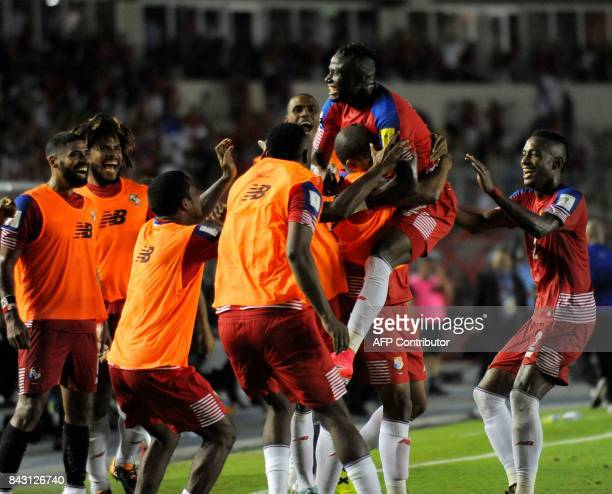 Panama's Abdiel Arroyo celebrates with teammates after scoring against Trinidad and Tobago's during their 2018 World Cup qualifier football match in...