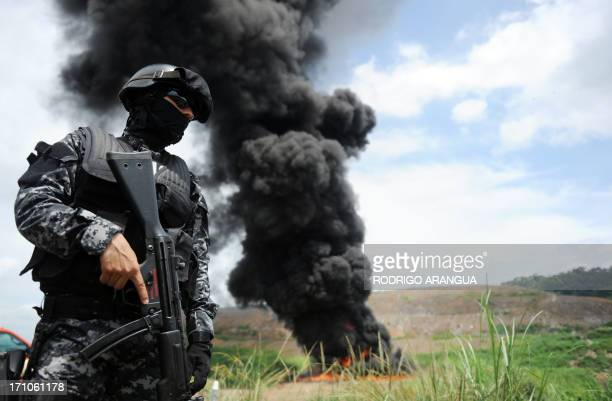Panama's antinarcotics personnel burn packs with part of a seizure of 11 tons of cocaine and 388 kg of marijuana in Cerro Patacon near Panama City on...