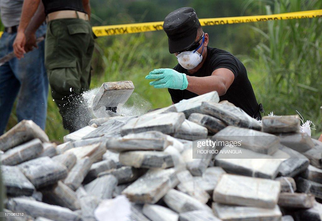 Panama's anti-narcotics personnel prepare to burn packs with part of a seizure of 11 tons of cocaine and 388 kg of marijuana in Cerro Patacon, near Panama City on June 21, 2013 AFP PHOTO/ Rodrigo ARANGUA