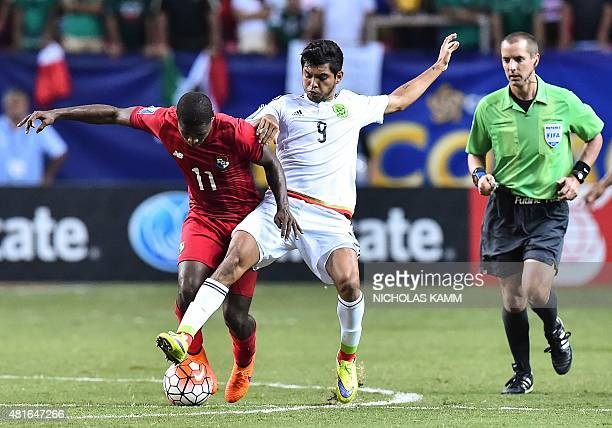 Panama's Armando Cooper vies with Mexico's Jesus Corona during a CONCACAF Gold Cup semifinal football match in Atlanta on July 22 2015 AFP...