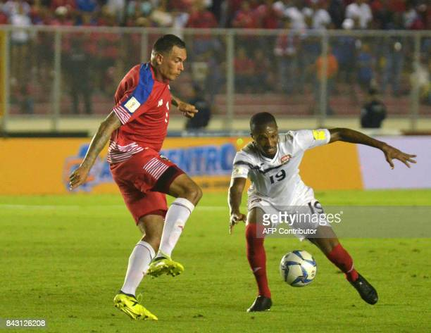 Panama's Blas Perez and Trinidad and Tobago's Kevan George vie for the ball during their 2018 World Cup qualifier football match in Panama City on...