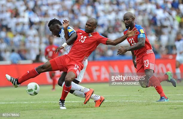 Panama's defender Adolfo Machado and Honduras' forward Alberth Elis vie for the ball as Panama's defender Felipe Baloy runs to assist his teammate...